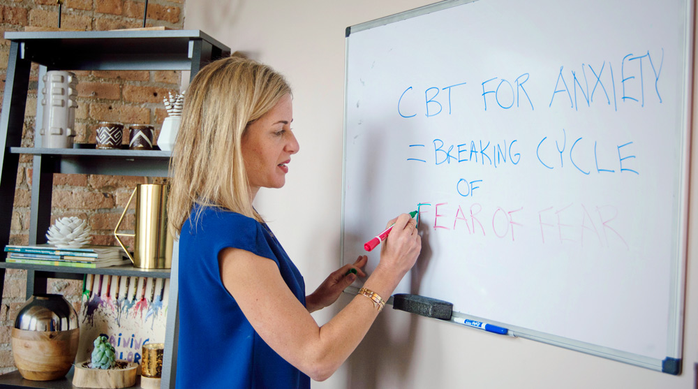 Debra writing on whiteboard